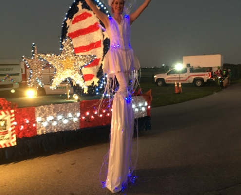 Stilt Lady and military float